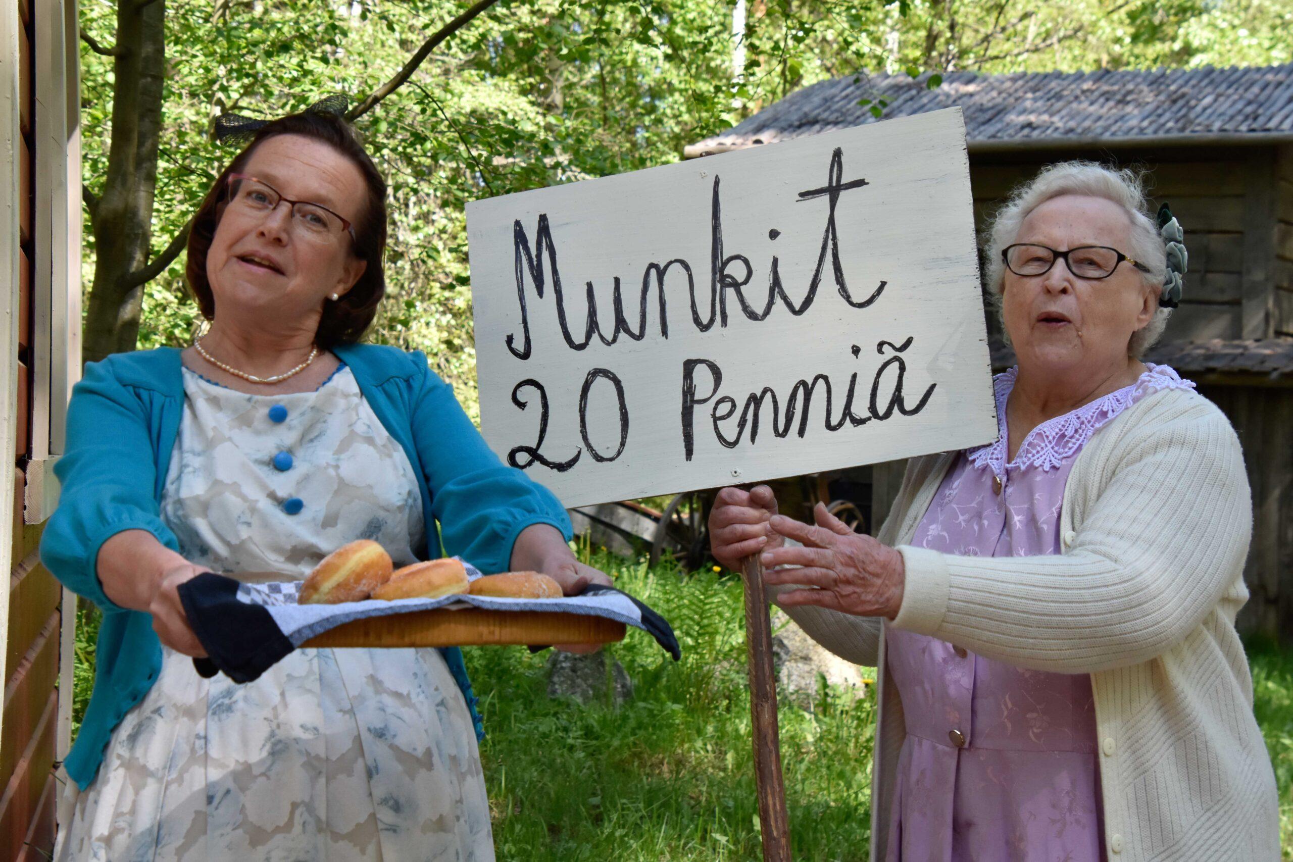 Kaksi naista myymässä munkkeja 20 pennillä.
