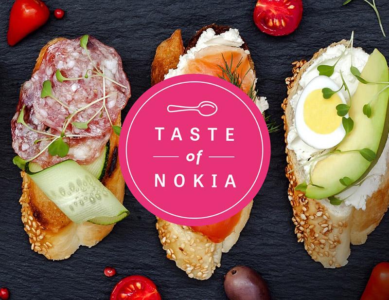 Tapahtuman logo, jossa Taste of Nokia -teksti valkoisella pinkin ympyrän sisällä ja tekstin yläpuolella valkoinen lusikka.